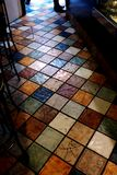 Colorful ceramic tile flooring in small narrow space in abstract view royalty free stock photos