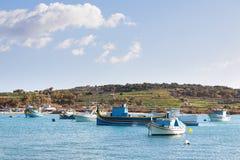 Colorful Mediterranean traditional boats, Marsaxlokk, Malta. Royalty Free Stock Photography