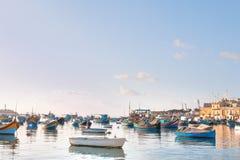 Colorful mediterranean traditional fisherman boats, Marsaxlokk, Malta. Stock Photos