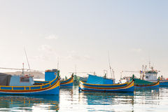 Colorful mediterranean traditional fisherman boats, Marsaxlokk, Malta. Royalty Free Stock Photography