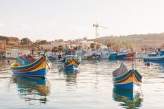 Colorful mediterranean traditional fisherman boats, Marsaxlokk, Malta. Stock Photo