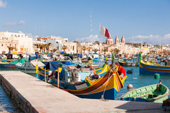 Colorful mediterranean traditional fisherman boats, Marsaxlokk, Malta. Royalty Free Stock Photos