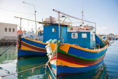 Colorful mediterranean traditional fishing boats. Marsaxlokk, Malta. Royalty Free Stock Photography