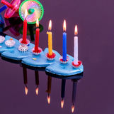 Colorful menorah with candles - Hanukkah Royalty Free Stock Photo