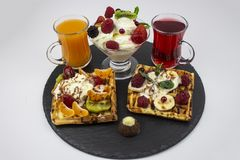 Colorful menu. waffles, ice cream, juice and berries. The concept of tasty food. copy space stock photo
