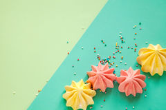Colorful meringue background mock up. Mint background colored meringue on the table decoration dessert Stock Images