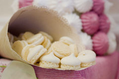 Colorful meringue beze cookies in a cup Stock Photos
