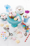 Colorful meringue cookies over white wooden background Royalty Free Stock Photo