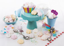 Colorful meringue cookies over white wooden background Stock Photo