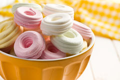 Colorful meringues in bowl Royalty Free Stock Image