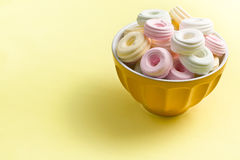Colorful meringues in bowl Stock Photo