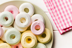 Colorful meringues on plate Stock Photo