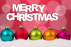 Colorful Merry Christmas card balls in a row decoration Stock Images