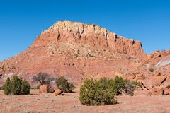 Colorful mesa in the red rock country of northern New Mexico in the American Southwest. Red rock mesa in the desert landscape of Ghost Ranch, Abiquiu near Santa royalty free stock images