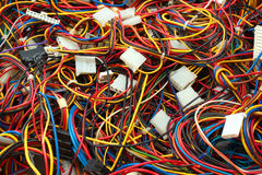 Colorful mess of cables wires and connectors royalty free stock image