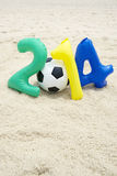 Colorful 2014 Message with Soccer Ball Football on Beach Royalty Free Stock Photos
