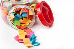 Colorful messages in a glass jar Royalty Free Stock Photography