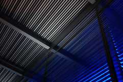 Colorful Metal Blinds, abstract background, gray and blue light. Colorful Jalousie shutters louvers over windows, gray and blue light Royalty Free Stock Photo