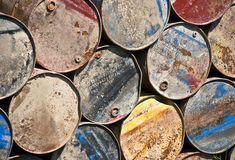 Colorful metal rusty circles of barrels in line Stock Images