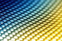 Colorful metal sheet background. Abstract background: Colorful perforated bent metal sheet grid stock photography