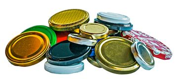 Colorful metalic lids for jars. Isolated on white background Royalty Free Stock Image