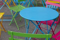 Colorful metallic table and chairs. Cafe furniture. Outdoor Stock Photo