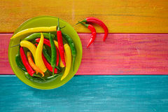 Colorful mexican chili peppers on wood table Royalty Free Stock Images