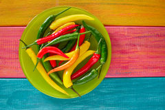 Colorful mexican chili peppers in wood table Stock Images
