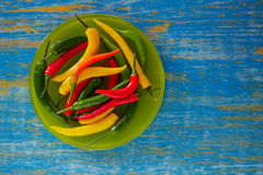 Colorful mexican chili peppers in wood table Stock Photo