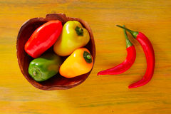 Colorful mexican chili peppers in yellow royalty free stock photos