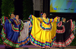Colorful Mexican female dancers dresses Royalty Free Stock Images