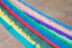 Colorful Mexican hammock over tile floor Stock Image