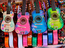 Colorful Mexican instruments. Four colorful Mexican ukuleles in a market stall Stock Images