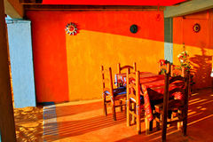Colorful mexican restaurant. Beach restaurant with brightly painted walls and colorful handcrafted tableclothes. Zipolite, Oaxaca, Mexico Stock Photo
