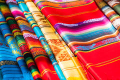 Colorful Mexican rugs from palenque, mexico. Colorful Mexican serapes hang in row. Woven sarapes Royalty Free Stock Image
