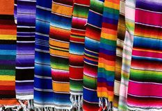 Colorful Mexican Serapes. Hang in row Royalty Free Stock Photo