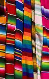 Colorful Mexican Serapes. Hang in row Royalty Free Stock Photography