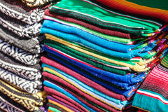 Colorful Mexican serapes hang in row. Mexican rugs from palenque, mexico Royalty Free Stock Photo