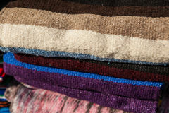 Colorful Mexican serapes hang in row. Mexican serape fabric colorful pattern texture background Royalty Free Stock Photos