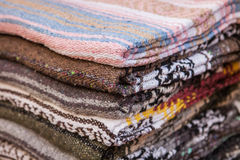 Colorful Mexican serapes hang in row. Mexican serape fabric colorful pattern texture background Stock Image