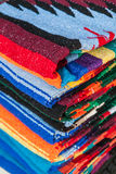 Colorful Mexican serapes hang in row. Royalty Free Stock Image