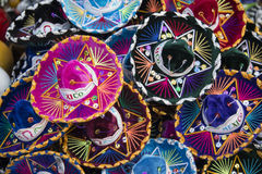 Colorful Mexican sombrero hats in Mexico. Colorful Mexican sombrero hats at an outdoor market in Mexico Royalty Free Stock Photography