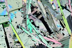 Colorful micro crystals in polarized light. Photo through a microscope of crystals growing from the melt of sulfur. Polarized light technology stock illustration