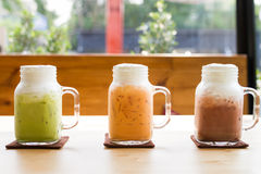 Colorful milk tea beverage on wood table Stock Photography
