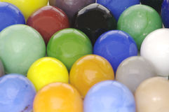 Colorful Milky Glass Toy Marbles. A background of assorted colorful opaque glass toy marbles form a colorful background Royalty Free Stock Photography