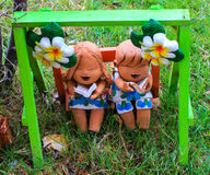 Colorful mini boy and girl  statuary. Reading the book Stock Photo