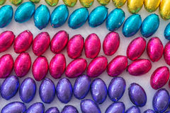 Colorful mini easter eggs in a rainbow of four colors Stock Image