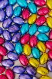Colorful mini easter eggs in various colors Stock Photography