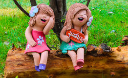 Colorful Mini girl statuary. On the stub Royalty Free Stock Images
