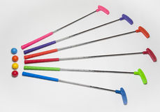 Colorful Mini Golf Clubs and Balls Stock Image